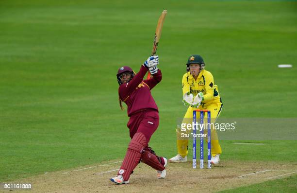 West Indies batsman Anisa Mohammed hits out watched by wicketkeeper Aliyssa Healy during the ICC Women's World Cup 2017 match between Australia and...