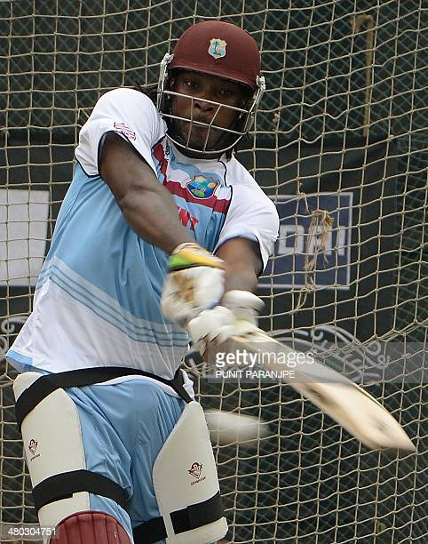 West Indies batsman Chris Gayle plays a shot during a training session at The ShereBangla National Cricket Stadium in Dhaka on March 24 2014 West...