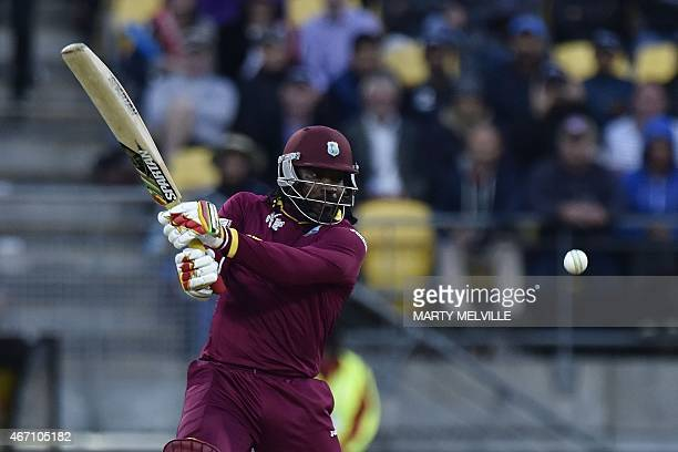 West Indies' batsman Chris Gayle plays a shot during the Cricket World Cup Quarter Final match between New Zealand and the West Indies at Wellington...