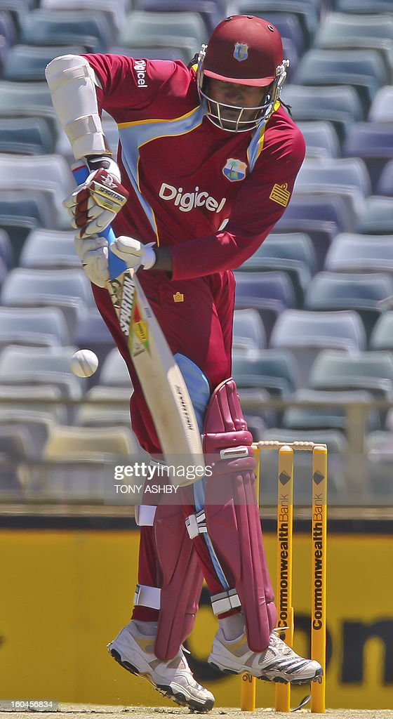 West Indies batsman Chris Gayle plays at a rising ball during the one-day international cricket match between Australia and the West Indies at the WACA ground on February 1, 2013. AFP PHOTO/Tony ASHBY IMAGE