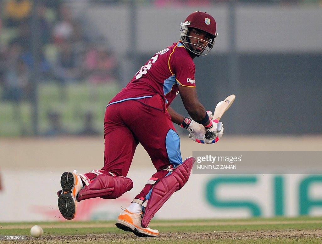 West Indies batsman Darren Bravo plays a shot during the fifth one day international between Bangladesh and West Indies at The Sher-e-Bangla National Cricket Stadium in Dhaka on December 8, 2012. AFP PHOTO/ Munir uz ZAMAN