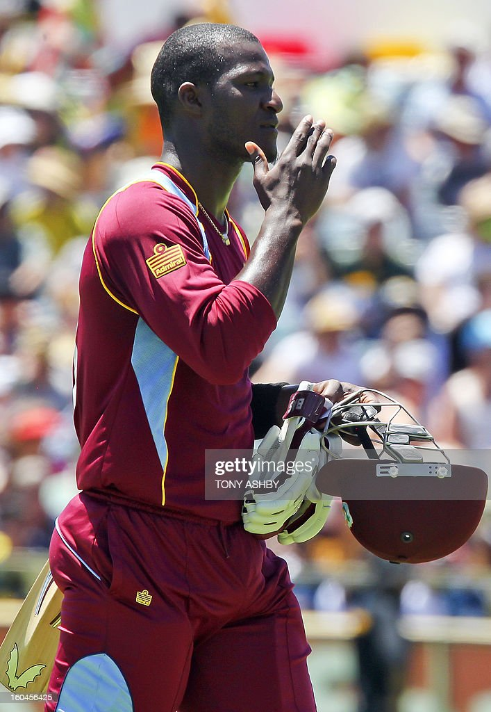West Indies batsman Darren Sammy gestures after losing his wicket during the one-day international cricket match between Australia and the West Indies at the WACA ground on February 1, 2013. AFP PHOTO/Tony ASHBY USE