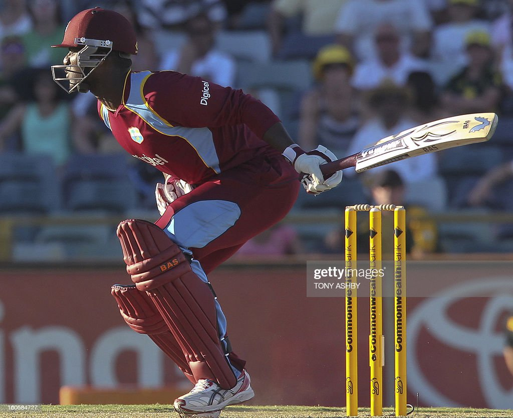 West Indies batsman Darren Sammy is hit in the groin by a ball from Australia's fast bowler Mitchell Johnson during the one-day international cricket match between Australia and the West Indies at the WACA ground in Perth on February 3, 2013. AFP PHOTO/Tony ASHBY USE