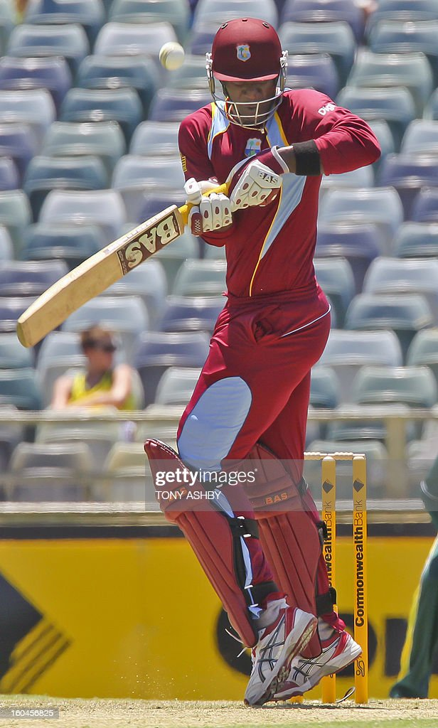 West Indies batsman Darren Sammy plays at a high ball during the one-day international cricket match between Australia and the West Indies at the WACA ground on February 1, 2013. AFP PHOTO/Tony ASHBY USE