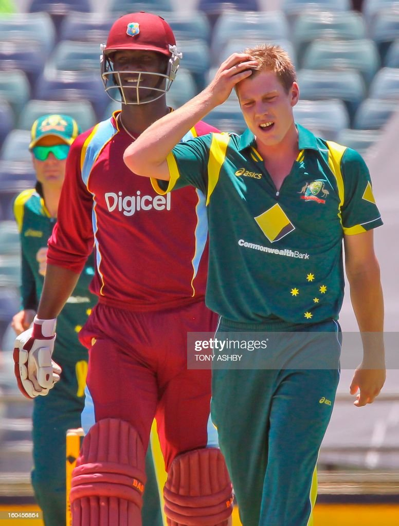 West Indies batsman Darren Sammy (L) survives an appeal for LBW from the bowling of Australia's James Faulkner (R) during the one-day international cricket match between Australia and the West Indies at the WACA ground on February 1, 2013. AFP PHOTO/Tony ASHBY USE