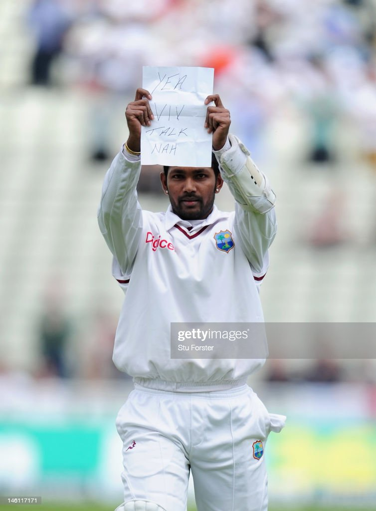 West Indies batsman <a gi-track='captionPersonalityLinkClicked' href=/galleries/search?phrase=Denesh+Ramdin&family=editorial&specificpeople=542842 ng-click='$event.stopPropagation()'>Denesh Ramdin</a> celebrates his century with a note for Viv Richards during day four of the 3rd Investec Test match between England and West Indies at Edgbaston on June 10, 2012 in Birmingham, England.