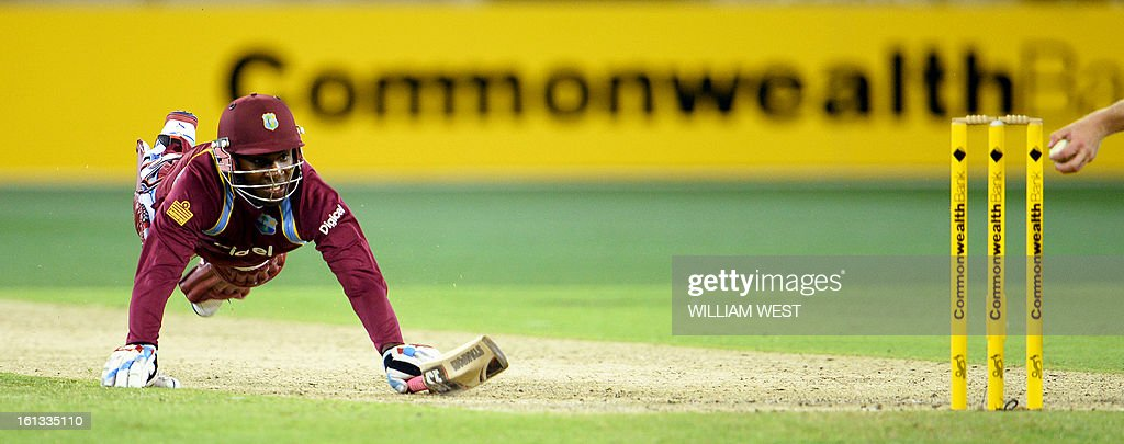 West Indies batsman Devon Thomas (L) dives for his crease but is run out by Australia's James Faulkner in their one-day cricket international played at the Melbourne Cricket Ground (MCG), on February 10, 2013. AFP PHOTO/William WEST IMAGE RESTRICTED TO EDITORIAL USE - STRICTLY NO COMMERCIAL USE