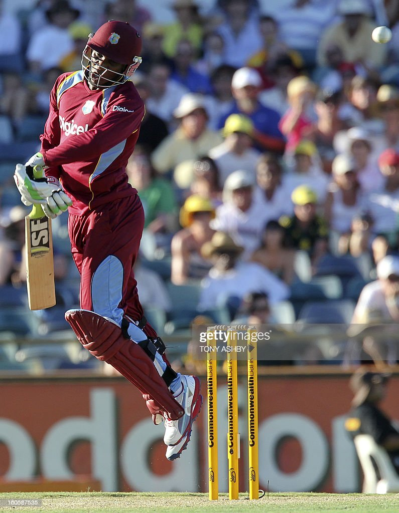 West Indies batsman Devon Thomas edges the ball to Australian wicketkeeper Matthew Wade (obscured) to be out during the one-day international cricket match between Australia and the West Indies at the WACA ground in Perth on February 3, 2013. AFP PHOTO/Tony ASHBY USE