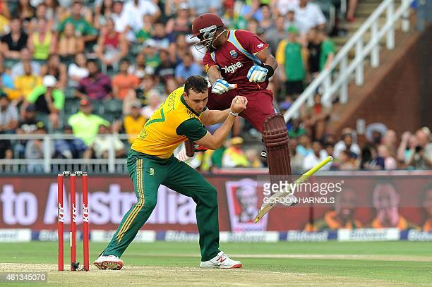West Indies batsman Dwayne Bravo collides with South African bowler Kyle Abbott during the second T20 cricket match between South Africa and the West...