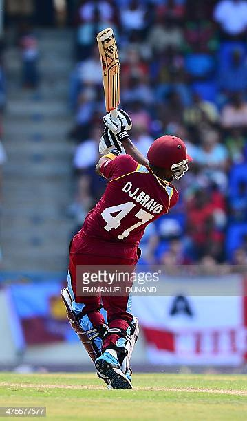 West Indies batsman Dwayne Bravo hits a boundary during the first One Day International match between West Indies and England at the Sir Vivian...