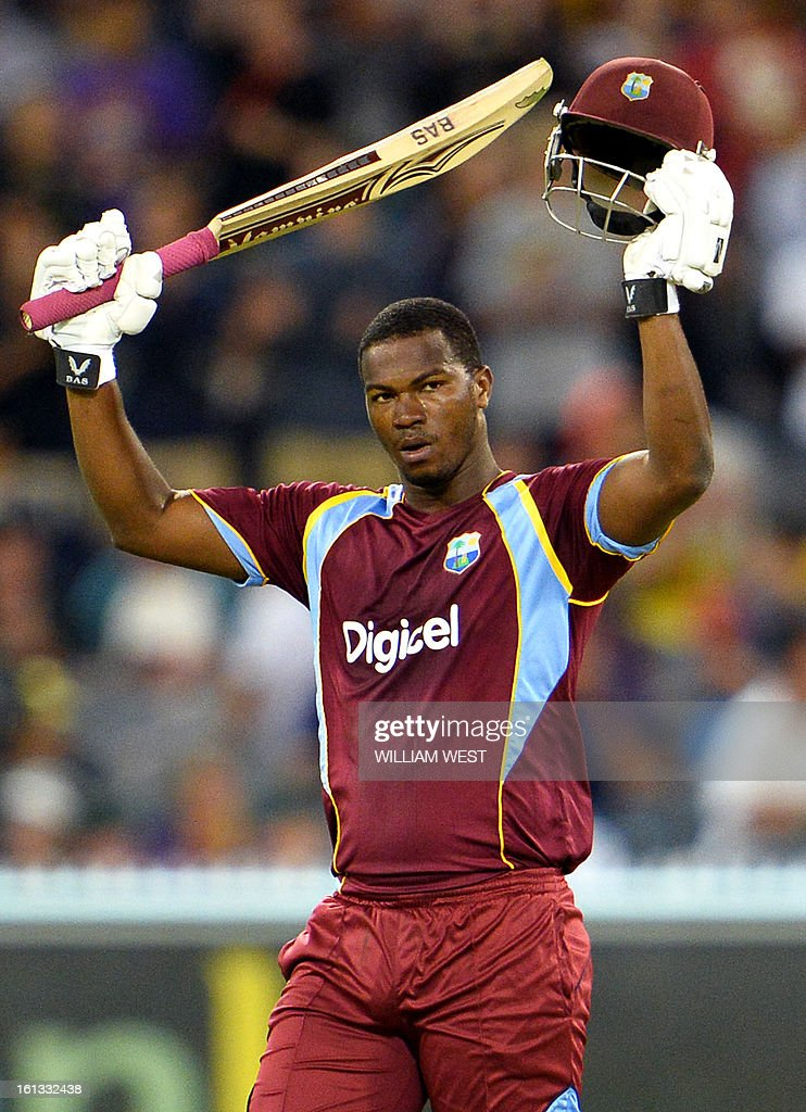 West Indies batsman Johnson Charles celebrates scoring his century against Australia in their one-day cricket international played at the Melbourne Cricket Ground (MCG), on February 10, 2013. AFP PHOTO/William WEST IMAGE