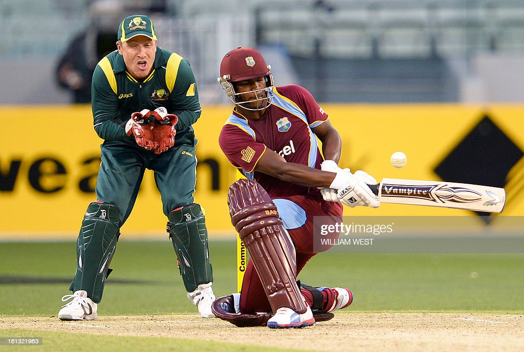West Indies batsman Johnson Charles (R) sweeps a ball as Australian wicketkeeper Brad Haddin (L) looks on in their one-day cricket international played at the Melbourne Cricket Ground (MCG), on February 10, 2013. AFP PHOTO/William WEST IMAGE