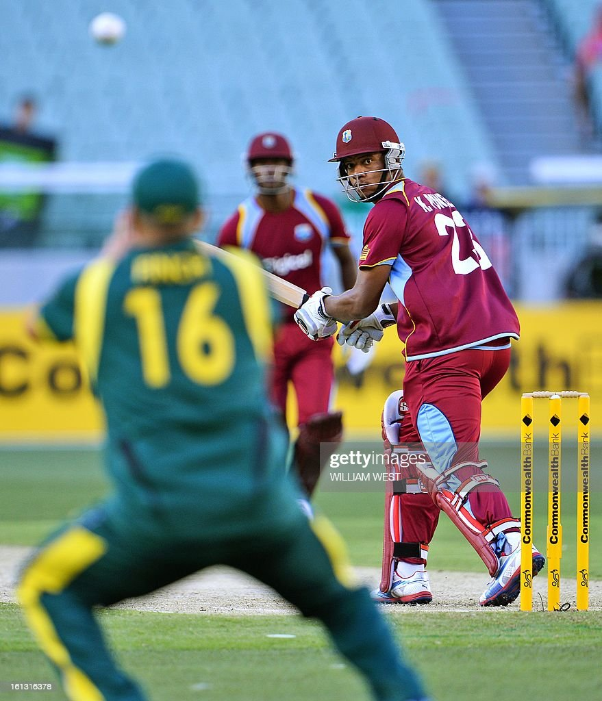 West Indies batsman Kieran Powell (R) is caught by Australian Aaron Finch (L) in their one-day cricket international played at the Melbourne Cricket Ground (MCG), on February 10, 2013. AFP PHOTO/William WEST IMAGE
