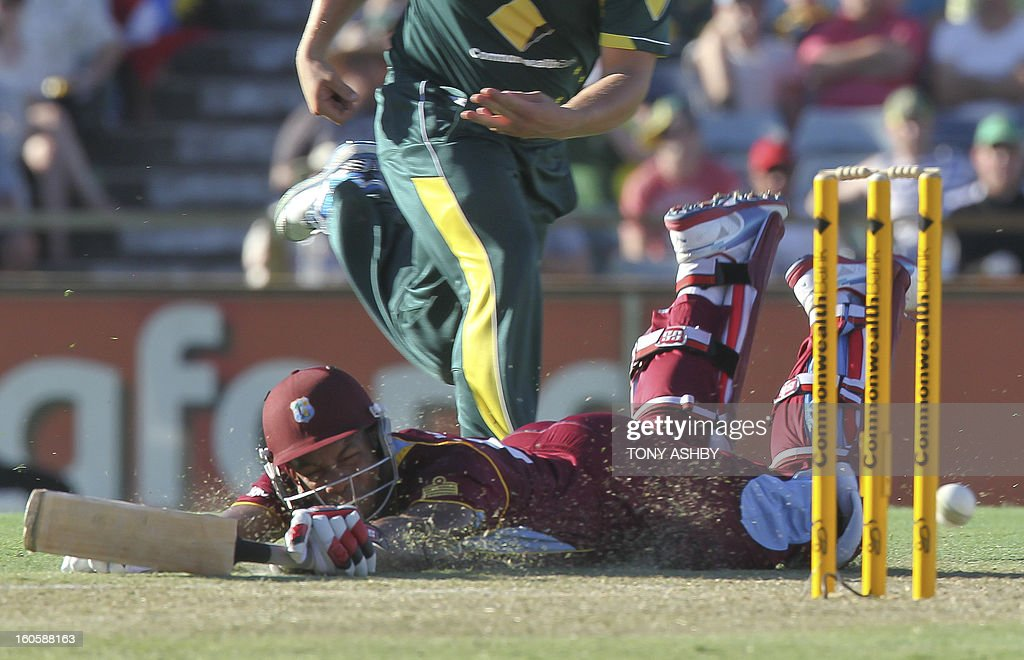 West Indies batsman Kieran Powell slides into his crease during the one-day international cricket match between Australia and the West Indies at the WACA ground in Perth on February 3, 2013. AFP PHOTO/Tony ASHBY USE