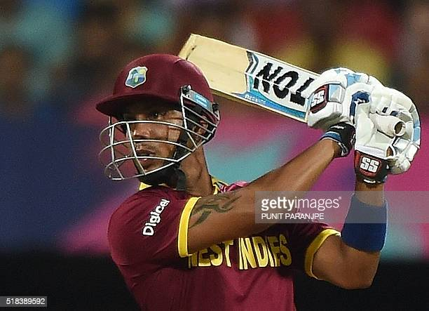 West Indies batsman Lendl Simmons plays a shot during the World T20 cricket tournament semifinal match between India and West Indies at The Wankhede...