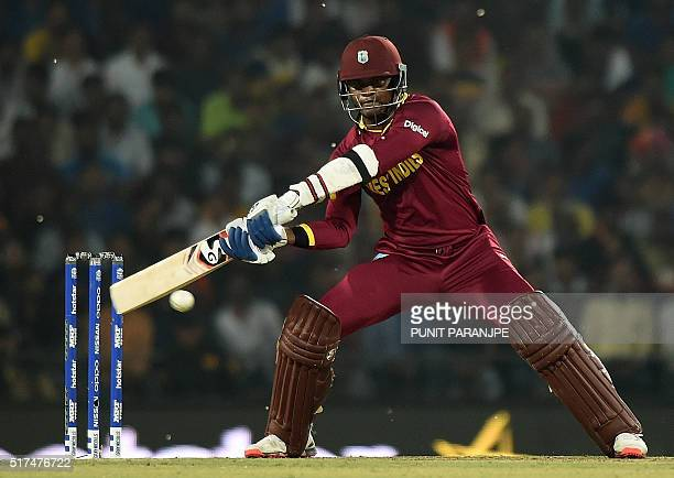 West Indies batsman Marlon Samuels plays a shot during the World T20 cricket tournament match between South Africa and West Indies at The Vidarbha...