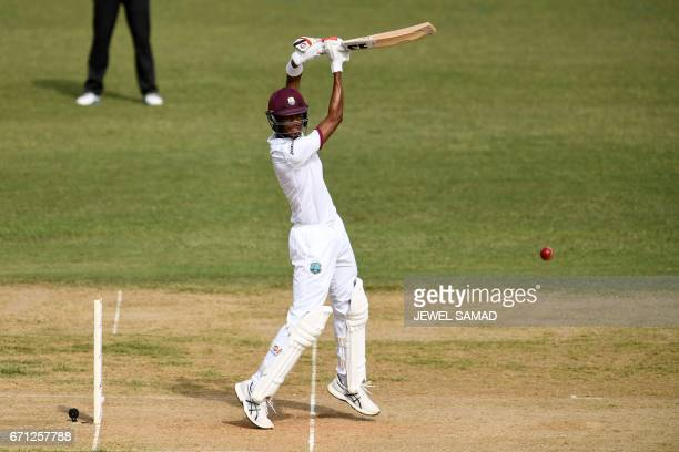 West Indies' batsman Roston Chase plays a shot on day one of the first Test match between West Indies and Pakistan at the Sabina Park in Kingston...