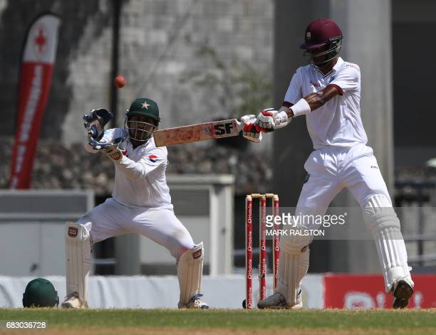 West Indies batsman Roston Chase plays a shot to covers past Pakistan wicketkeeper Sarfraz Ahmed on the fifth day of play of the final test match at...