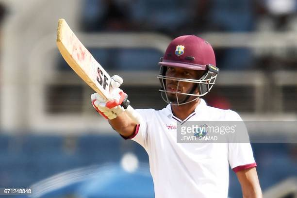 West Indies' batsman Roston Chase reacts after scoring his half century on day one of the first Test match between West Indies and Pakistan at the...
