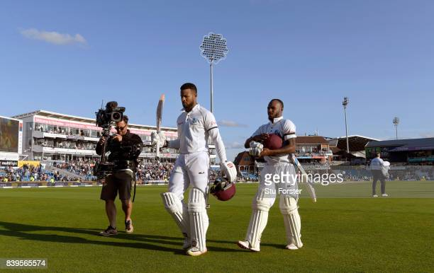 West Indies batsman Shai Hope acknowledges the crowd as he leaves the field with Jermaine Blackwood unbeaten on 147 at the end of day two during day...