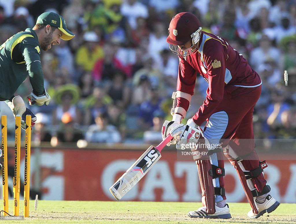 West Indies batsman Sunil Narine (R) is stumped by Australian wicketkeeper Matthew Wade (L) during the one-day international cricket match between Australia and the West Indies at the WACA ground in Perth on February 3, 2013. AFP PHOTO/Tony ASHBY USE