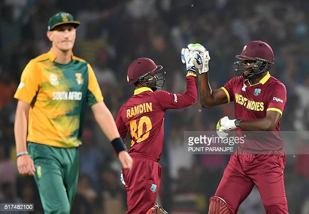 West Indies batsmen Carlos Brathwaiteand Denesh Ramdincelebrate after winning the World T20 cricket tournament match against South Africa at The...