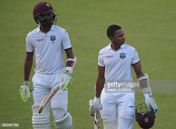 West Indies' batsmen Kraigg Brathwaite and Shane Dowrich walk back to pavilion at the end of the fourth day of the third and final Test between...