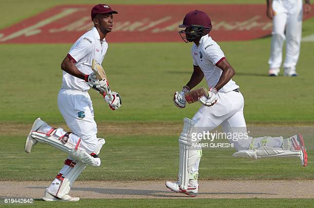 West Indies' batsmen Roston Chase and Kraigg Brathwaite run between the wickets on the second day of the third and final Test between Pakistan and...