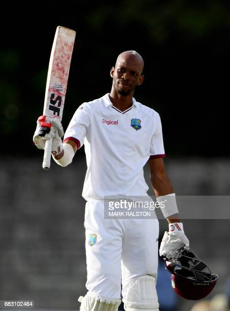West Indies batsmen Roston Chase celebrates after scoring his 100 against Pakistan on the fifth days play of the final test match at the Windsor Park...