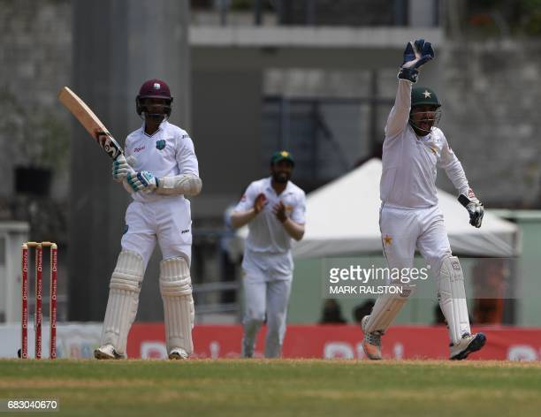 West Indies batsmen Shane Dowrich watches as wicketkeeper Sarfraz Ahmed of Pakistan appeals to the umpire before Dowrich was declared out caught by...