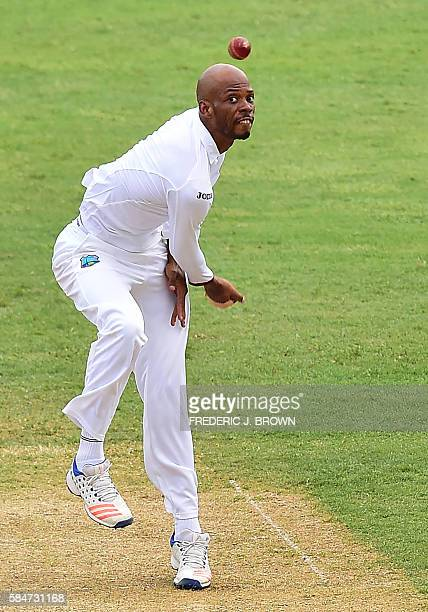 West Indies bolwer Roston Chase eyes his delivery to India's Cheteshwar Purjara in the 22nd over on July 30 2016 in Kingston Jamaica on the first day...