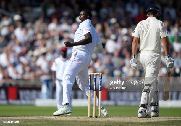 West Indies bowler Jason Holder celebrates after dismissing Alastair Cook during day three of the 2nd Investec Test match between England and West...