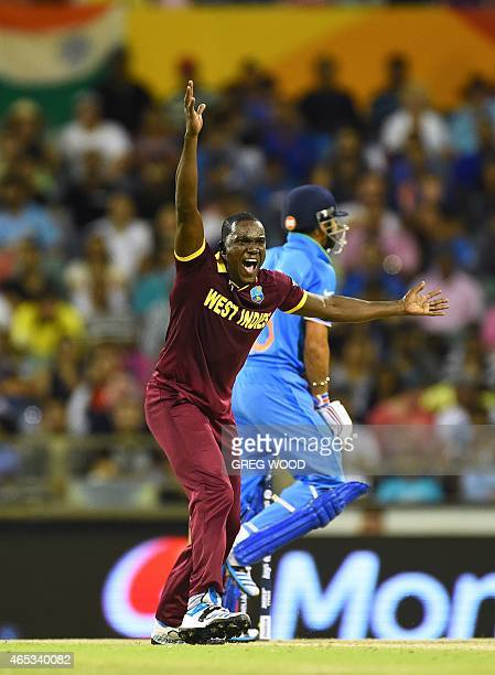 West Indies bowler Jerome Taylor appeals unsuccessfully against India's Virat Kohli during the 2015 Cricket World Cup Pool B match between India and...