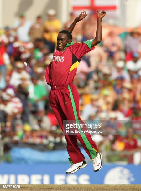 West Indies bowler Jerome Taylor celebrates a run out during the World Cup Super Eight match between West Indies and England at the Kensington Oval...
