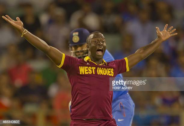 West Indies bowler Kemar Roach appeals for the wicket of Indian batsman Virat Kohli during the 2015 Cricket World Cup Pool B match between the West...