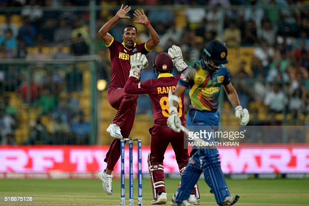 West Indies bowler Samuel Badree celebrates the wicket of Sri Lankan batsman Milinda Siriwardana with wicketkeeper Denesh Ramdin during the World T20...