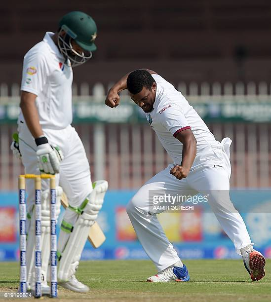 West Indies' bowler Shannon Gabriel celebrates after taking the wicket of Pakistani batsman Azhar Ali on the first day of the third and final Test...