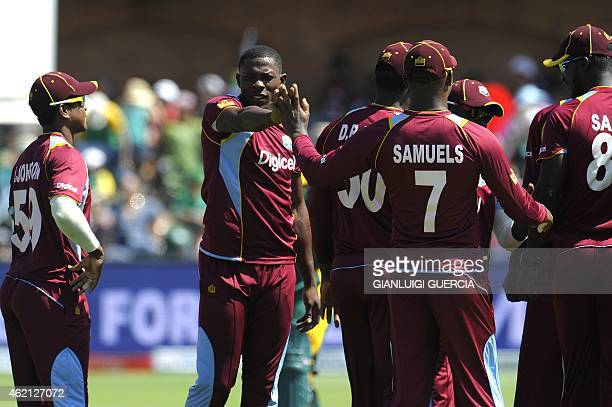 West Indies bowler Sheldon Cottrell celebrates with teammates after taking the wicket of South African batsman Rille Rossouw during the 4th One Day...