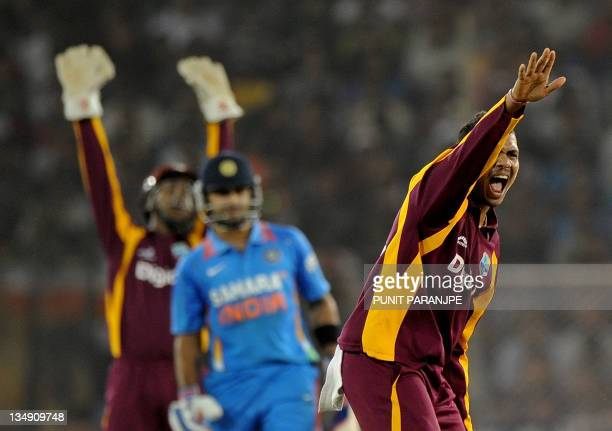 West Indies bowler Sunil Narine appeals successfully for the wicket of Indian batsman Virat Kohli during the third oneday international cricket match...