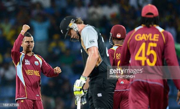 West Indies bowler Sunil Narine celebrates the wicket of New Zealand cricketer Jacob Oram with teammates during the ICC Twenty20 Cricket World Cup...
