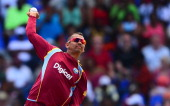 West Indies bowler Sunil Narine delivers a ball during the second One Day International match between West Indies and England at the Sir Vivian...