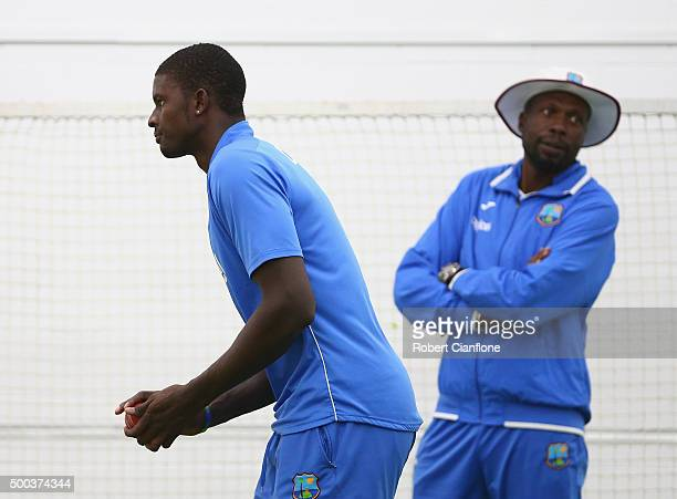 West Indies bowling consultant Curtly Ambrose looks on as Jason Holder of the West Indies bowls during a West Indies training session at Blundstone...