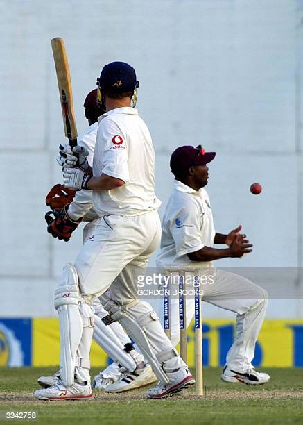 West Indies captain Brian Lara fields at first slip dropping England's batsman Andrew Flintoff on the third day of the fourth and final CW Test 12...