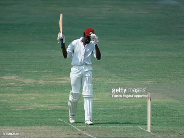 West Indies captain Clive Lloyd celebrates reaching 100 runs during the Prudential World Cup Final between Australia and West Indies at Lord's...