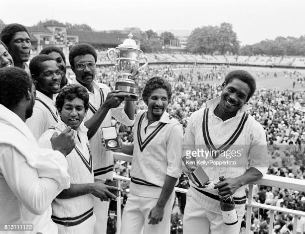 West Indies captain Clive Lloyd holds up the Prudential World Cup surrounded by his team after West Indies' victory over England by 92 runs in the...