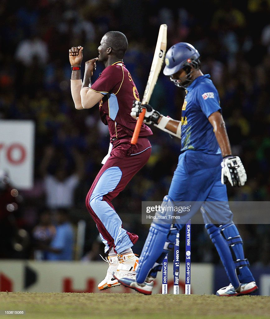 West Indies captain Darren Sammy celebrates after the dismissal of Sri Lankan player Lahiru Thirimanne during the ICC World T20 cricket Final between Sri Lanka and West Indies at R. Premadasa Stadium on October 7, 2012 in Colombo, Sri Lanka.