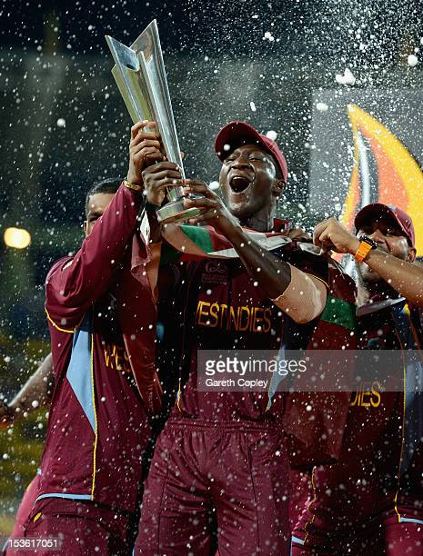 West Indies captain Darren Sammy lifts the trophy after winning the ICC World Twenty20 2012 Final between Sri Lanka and the West Indies at R...