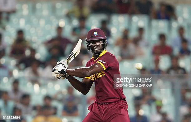 West Indies captain Darren Sammy plays a shot during a practice match between Australia and West Indies during the World T20 cricket tournament at...