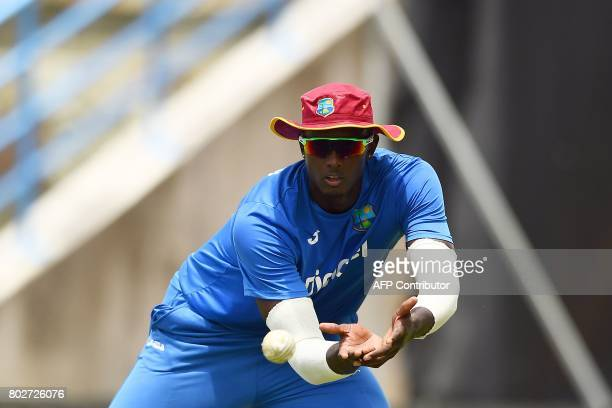 TOPSHOT West Indies' captain Jason Holder catches a ball during a practice session at the Sir Vivian Richards Cricket Ground in St John's Antigua on...