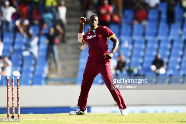 West Indies' captain Jason Holder celebrates after bowling out India's Hardik Pandya during the fourth One Day International match between West...